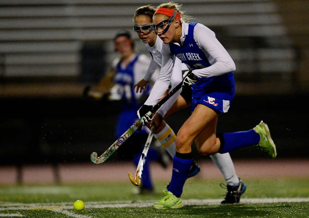 . Colorado Academy\'s Julia Murphy defends as Cherry Creek\'s Blair Sisk controls the ball during the CHSAA state field hockey championship. Colorado Academy (17-0) capped a perfect season at All-City Stadium. (Photo by AAron Ontiveroz/The Denver Post)