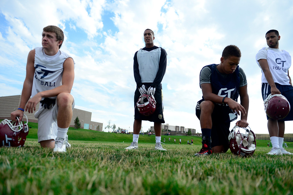 . Evan White (center) takes a breather during the first day of practice. Cherokee Trail lost to Valor Christian in last year\'s 5A state title game. (Photo by AAron Ontiveroz/The Denver Post)
