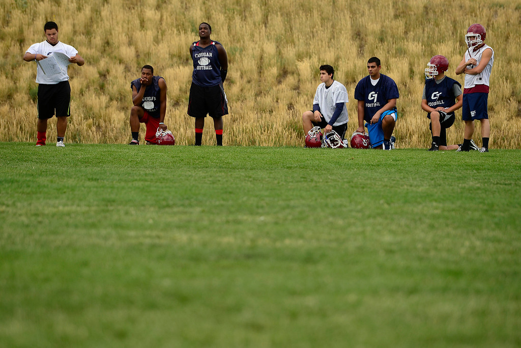 . Players run through drills during the first day of practice. Cherokee Trail lost to Valor Christian in last year\'s 5A state title game. (Photo by AAron Ontiveroz/The Denver Post)