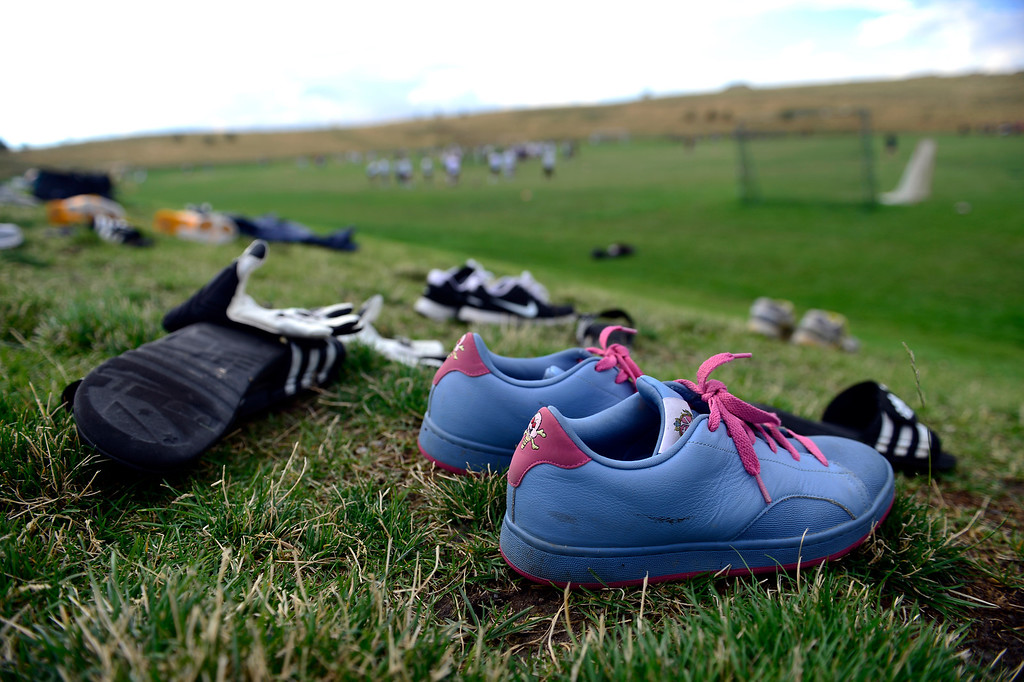 . Cherokee Trail players\' shoes sit along an adjacent hillside during the first day of practice. Cherokee Trail lost to Valor Christian in last year\'s 5A state title game. (Photo by AAron Ontiveroz/The Denver Post)