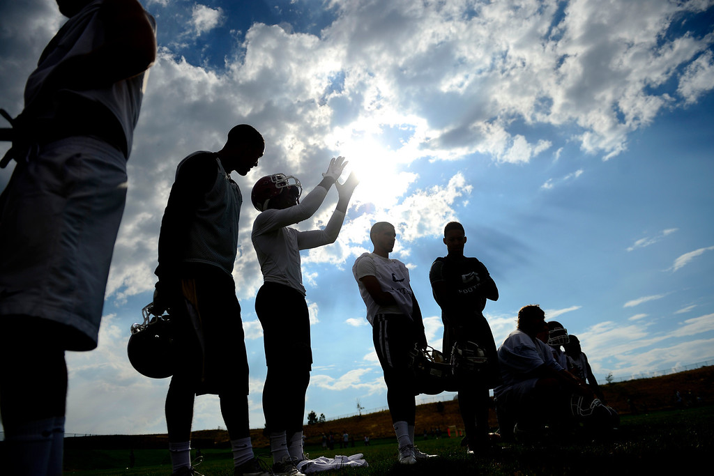 . Jacob Martin raises his hands during the first day of practice. Cherokee Trail lost to Valor Christian in last year\'s 5A state title game. (Photo by AAron Ontiveroz/The Denver Post)