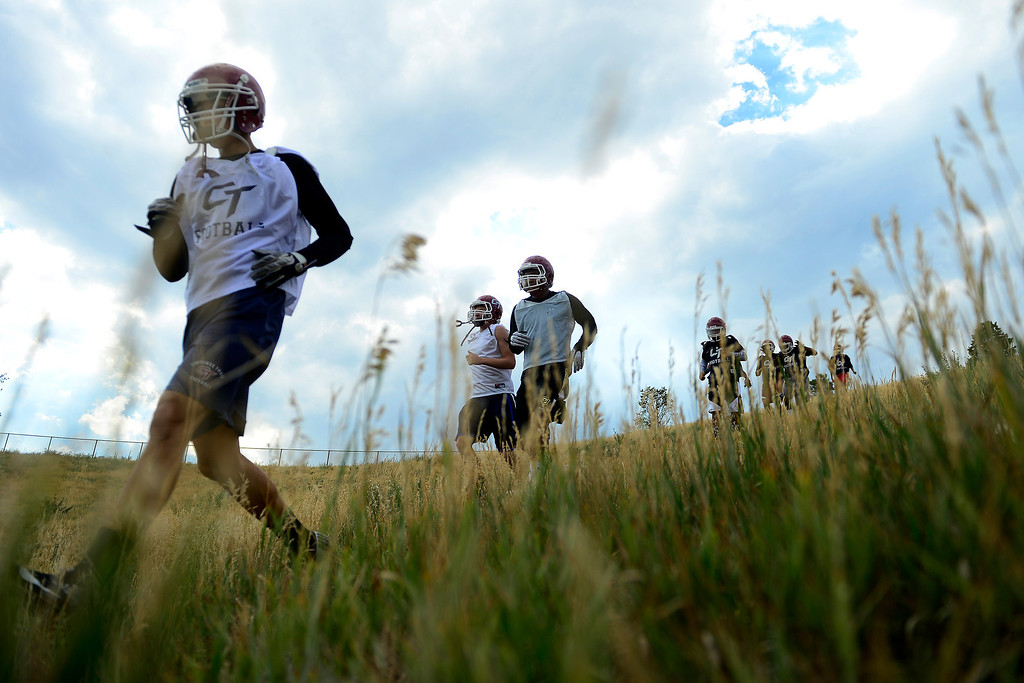 . Cherokee Trail players run hills during the first day of practice. Cherokee Trail lost to Valor Christian in last year\'s 5A state title game. (Photo by AAron Ontiveroz/The Denver Post)