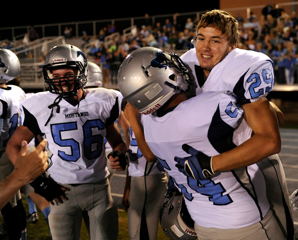 . DENVER, CO. - AUGUST 23: Lineman Conner Zimmerman (54) lifted running back Kyle Rush (29) into the air following his touchdown run late in the fourth quarter. The Ralston Valley High School football team beat Mullen 43-0 Friday night, August 23, 2013. Photo By Karl Gehring/The Denver Post