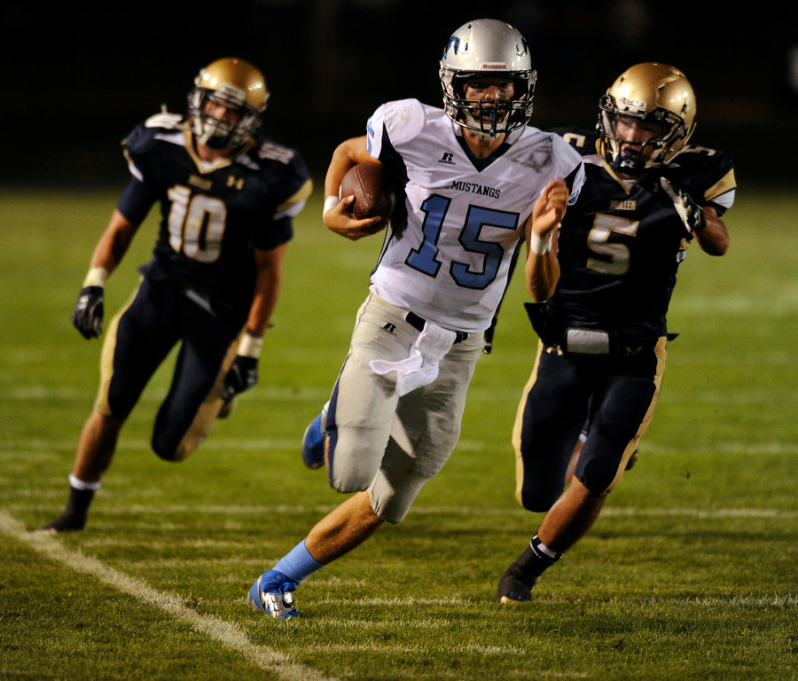 . DENVER, CO. - AUGUST 23: Ralston Valley quarterback Jacob Knipp (15) was chased down the sideline in the third quarter. The Ralston Valley High School football team beat Mullen 43-0 Friday night, August 23, 2013. Photo By Karl Gehring/The Denver Post