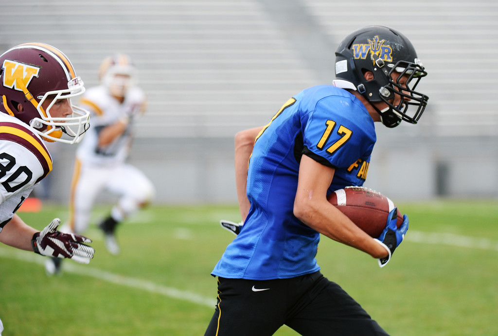 . LAKEWOOD, CO - August 30 : Dakota Koenecke of Wheat Ridge High School (17) controls the ball against Windsor High School in the 1st half of the game at Jefferson County Stadium. Lakewood, Colorado. August 30, 2013. (Photo by Hyoung Chang/The Denver Post)