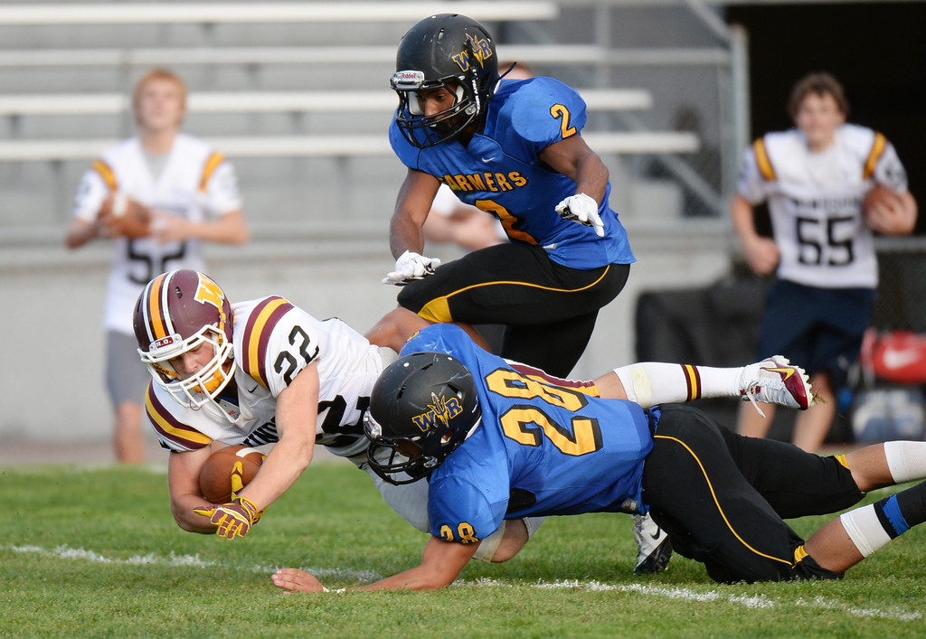 . LAKEWOOD, CO - August 30 : Wil Dressor of Windsor High School (22) dives for the touchdown against Jordan Jones (28) and Averee Mason (2) of Wheat Ridge High School Windsor High School in the first half of the game at Jefferson County Stadium. Lakewood, Colorado. August 30, 2013. (Photo by Hyoung Chang/The Denver Post)