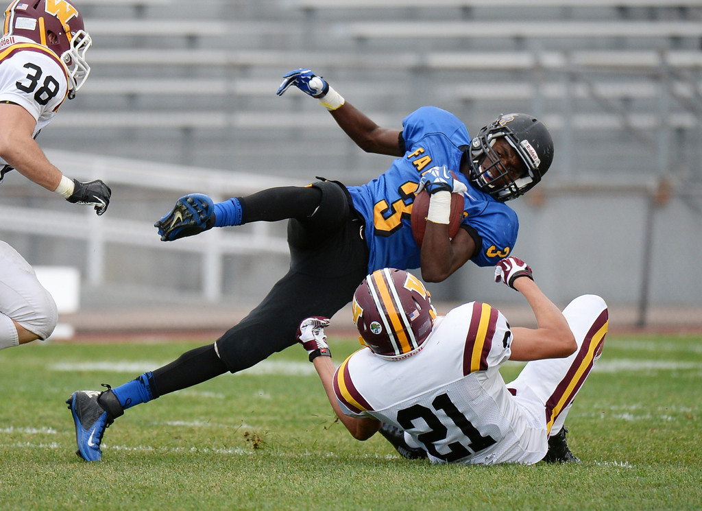 . LAKEWOOD, CO - August 30 : Anthony McGinnis of Wheat Ridge High School (3) dives for the first down against Connor Hoffman of Windsor High School (21) in the first half of the game at Jefferson County Stadium. Lakewood, Colorado. August 30, 2013. (Photo by Hyoung Chang/The Denver Post)