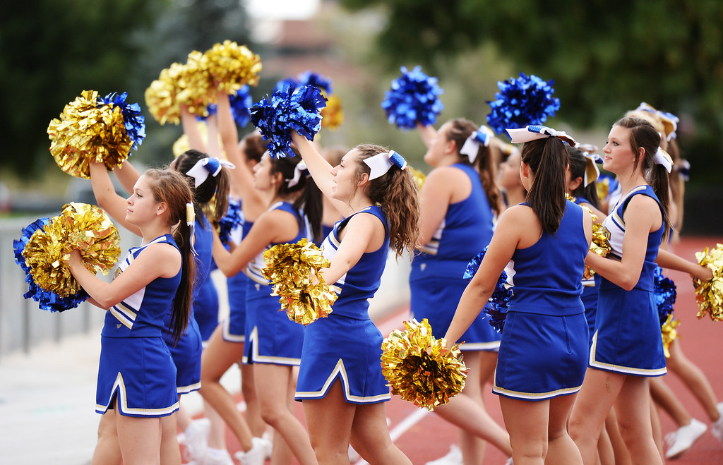 . LAKEWOOD, CO - August 30 : Wheat Ridge High School cheerleaders on the sideline during the game against Windsor High School at Jefferson County Stadium. Lakewood, Colorado. August 30, 2013. (Photo by Hyoung Chang/The Denver Post)