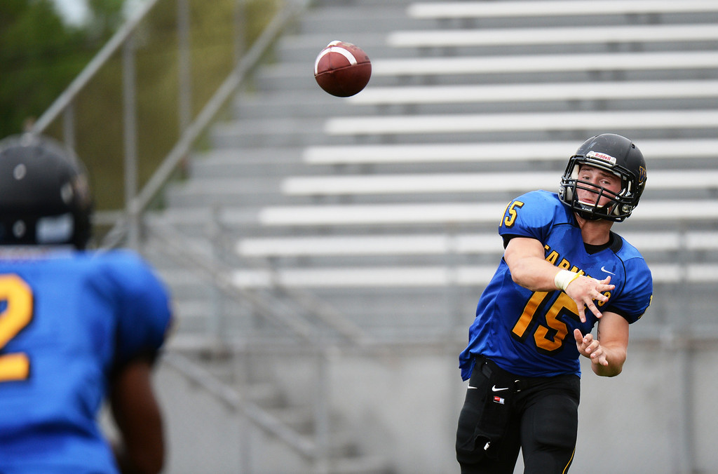 . LAKEWOOD, CO - August 30 : QB Tanner Weakland of Wheat Ridge High School (15) connects a pass with Averee Mason (2) during the 1st half of the game against Windsor High School at Jefferson County Stadium. Lakewood, Colorado. August 30, 2013. (Photo by Hyoung Chang/The Denver Post)