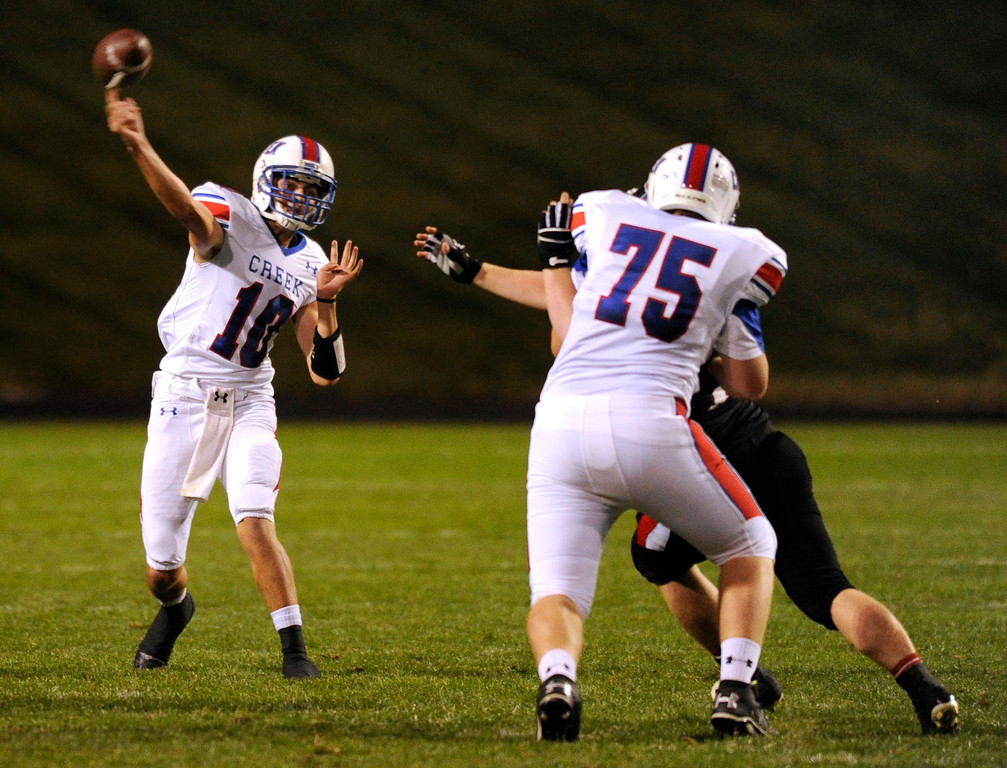 . ARVADA, CO. - SEPTEMBER 6: Bruins\' quarterback Nate Sweeney (10) fired over the middle in the second quarter. The Pomona High School football team hosted Cherry Creek Friday night, September 6, 2013. Photo By Karl Gehring/The Denver Post