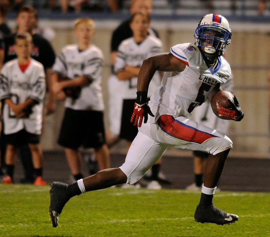 . ARVADA, CO. - SEPTEMBER 6: Bruins\' running back broke free for a third quarter touchdown. The Cherry Creek High School football team defeated Pomona 19-15 Friday night, September 6, 2013. Photo By Karl Gehring/The Denver Post