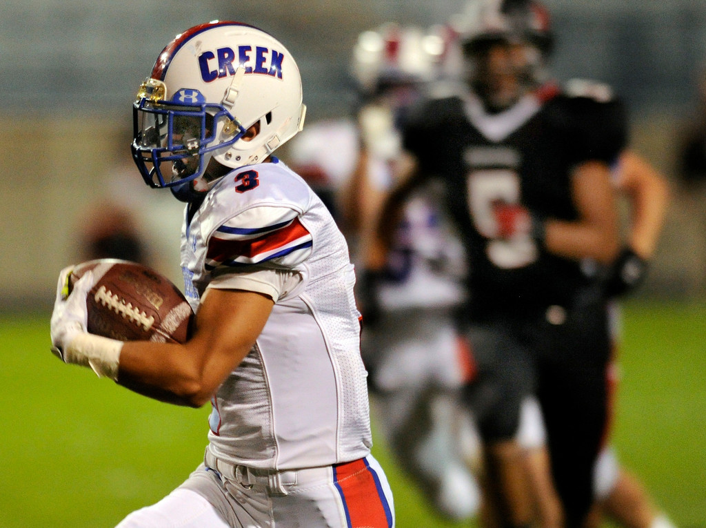 . ARVADA, CO. - SEPTEMBER 6: Creek wide receiver Joseph Parker (3) ran to the end zone on a reverse in the second half. The Cherry Creek High School football team defeated Pomona 19-15 Friday night, September 6, 2013. Photo By Karl Gehring/The Denver Post