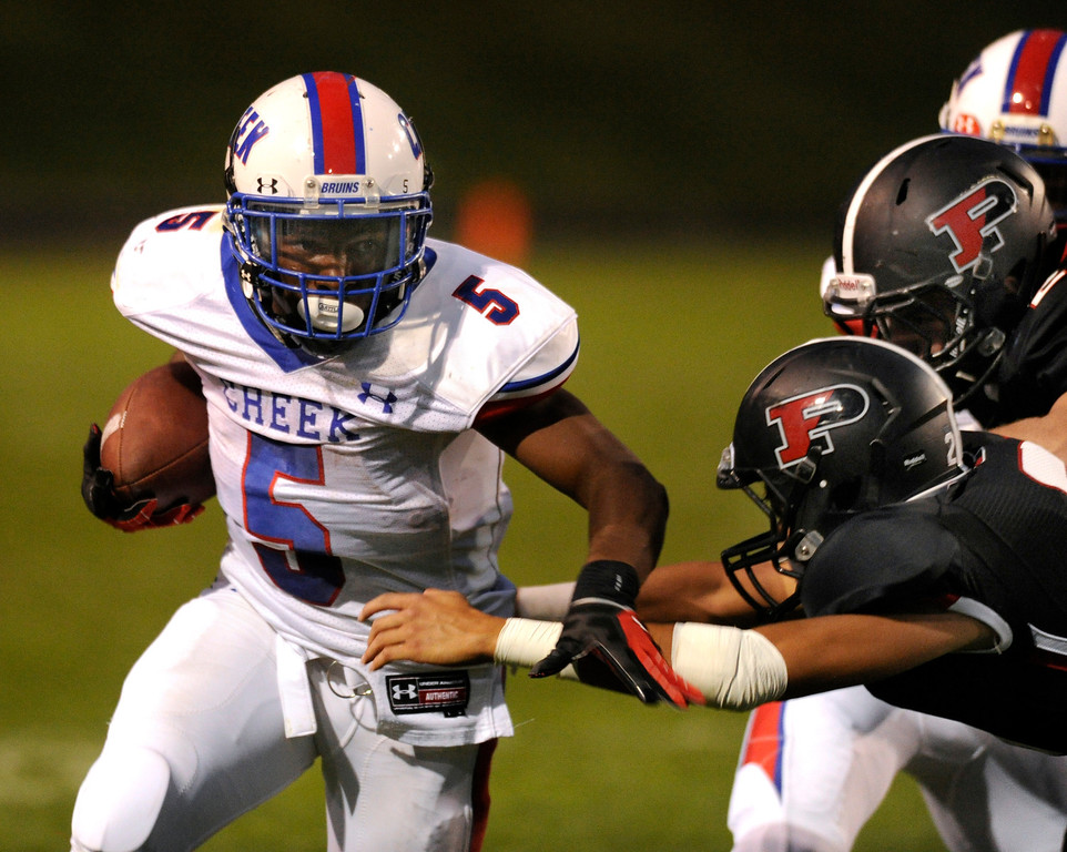 . ARVADA, CO. - SEPTEMBER 6: Bruins\' running back Milo Hall (5) found room to run in the second quarter. The Pomona High School football team hosted Cherry Creek Friday night, September 6, 2013. Photo By Karl Gehring/The Denver Post