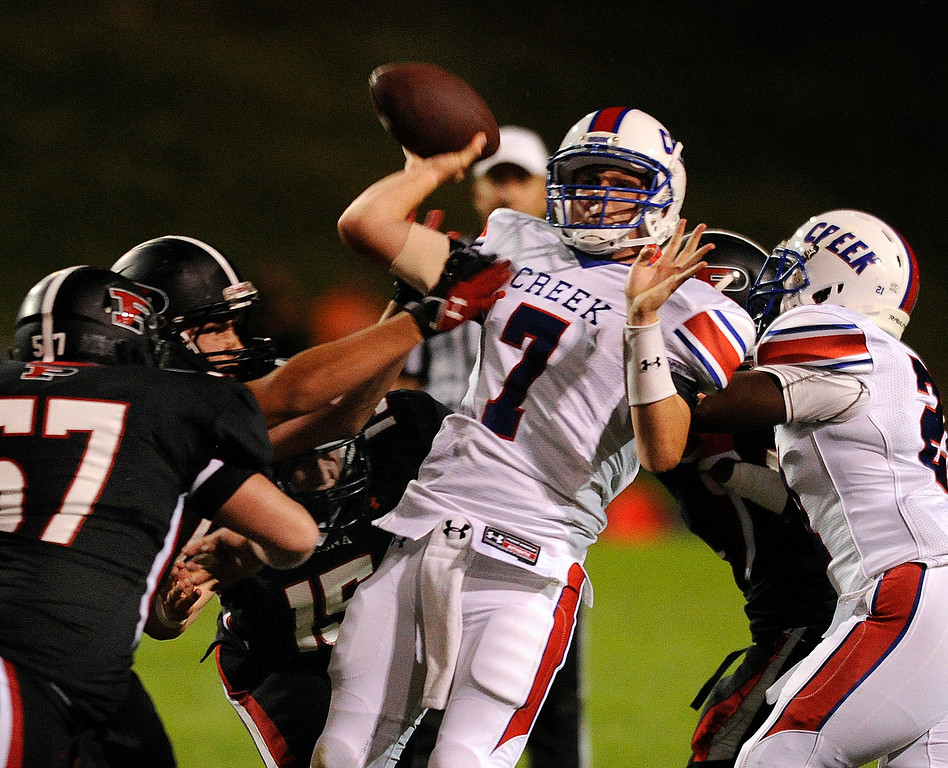 . ARVADA, CO. - SEPTEMBER 6: Bruins\' quarterback Cameron Brucker (7) threw under pressure. The Cherry Creek High School football team defeated Pomona 19-15 Friday night, September 6, 2013. Photo By Karl Gehring/The Denver Post