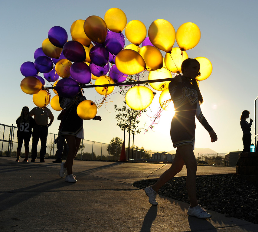 . BROOMFIELD, CO. - SEPTEMBER 20: Holy Family cheerleaders carried balloons into place before the game. The Holy Family High School football team hosted Silver Creek Friday night September 20, 2013.  Photo By Karl Gehring/The Denver Post