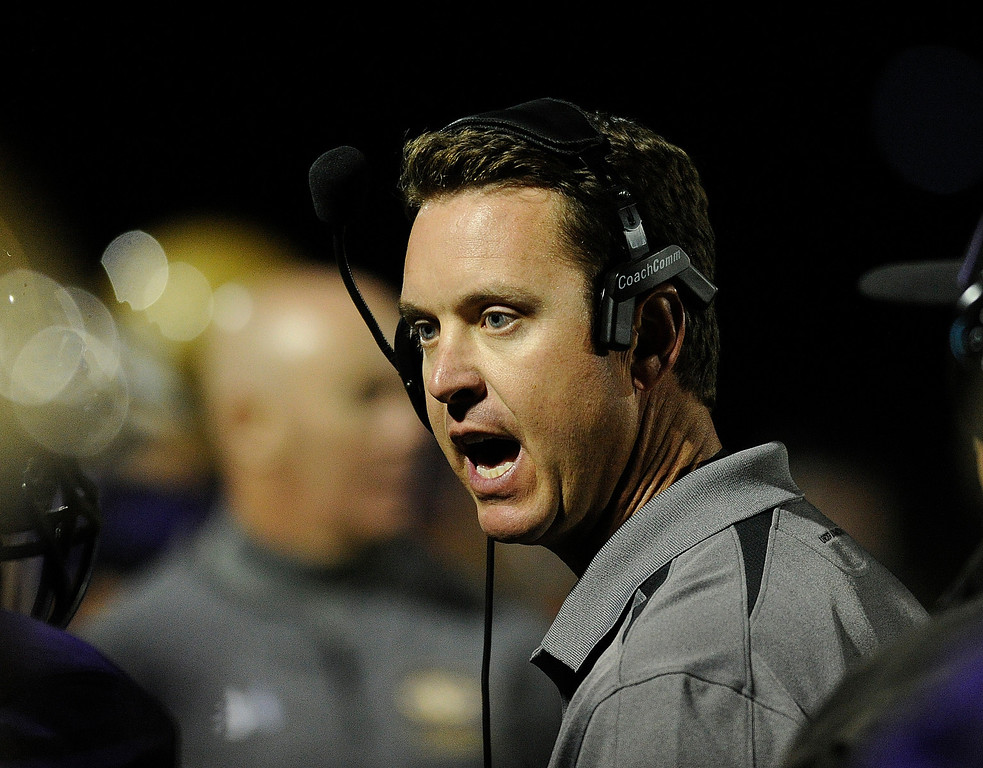 . BROOMFIELD, CO. - SEPTEMBER 20: Holy Family coach Mike Gabriel talked to the team in the second half. The Silver Creek High School football team defeated Holy Family 45-14 Friday night September 20, 2013 in Broomfield.  Photo By Karl Gehring/The Denver Post