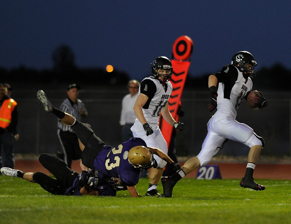 . BROOMFIELD, CO. - SEPTEMBER 20: Silver Creek receiver Zane Lindsey (11) gets past the last of the Holy Family defenders for a touchdown in the first half. The Holy Family High School football team hosted Silver Creek Friday night September 20, 2013.  Photo By Karl Gehring/The Denver Post
