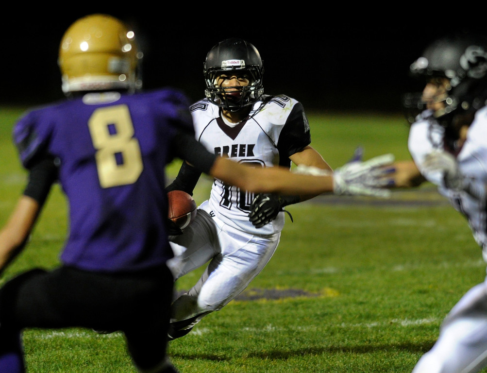 . BROOMFIELD, CO. - SEPTEMBER 20: Silver Creek running back Anthony Kasper (10) looked for room to run in the second half. The Silver Creek High School football team defeated Holy Family 45-14 Friday night September 20, 2013 in Broomfield.  Photo By Karl Gehring/The Denver Post