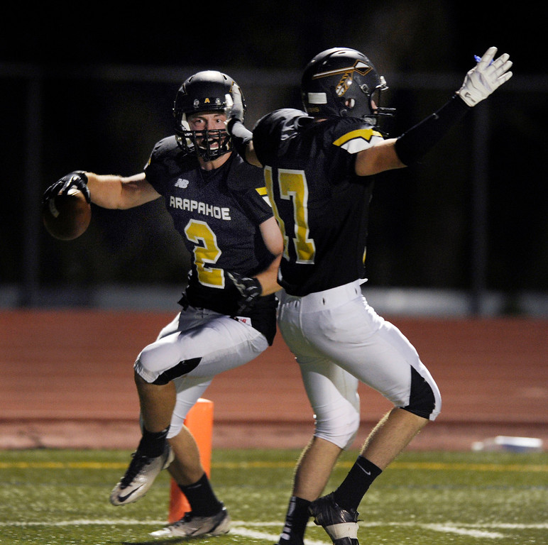 . Arapahoe senior receiver Brandon Jewell (2) scored the Warriors first touchdown in the first quarter. The Arapahoe High School football team hosted Columbine at the Littleton Public Schools District Stadium Thursday night, September 26, 2013. Photo By Karl Gehring/The Denver Post