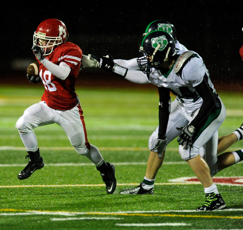 . AURORA, CO. - SEPTEMBER 27: Regis wide receiver Jared Marien (48) headed for the edge on a  reverse in the second half. The Regis Jesuit High School football team steamrolled  ThunderRidge 35-12 Friday night, September 27, 2013. Photo By Karl Gehring/The Denver Post