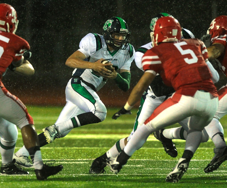 . AURORA, CO. - SEPTEMBER 27: ThunderRidge quarterback Brody Westmoreland (17) went up the middle with the ball in the first quarter. The Regis Jesuit High School football team hosted ThunderRidge Friday night, September 27, 2013. Photo By Karl Gehring/The Denver Post