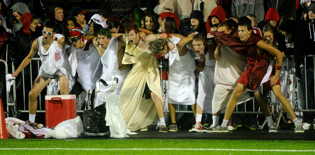 . AURORA, CO. - SEPTEMBER 27: Regis fans ignored the rain to cheer on the Raiders Friday night. The Regis Jesuit High School football team hosted ThunderRidge Friday night, September 27, 2013. Photo By Karl Gehring/The Denver Post