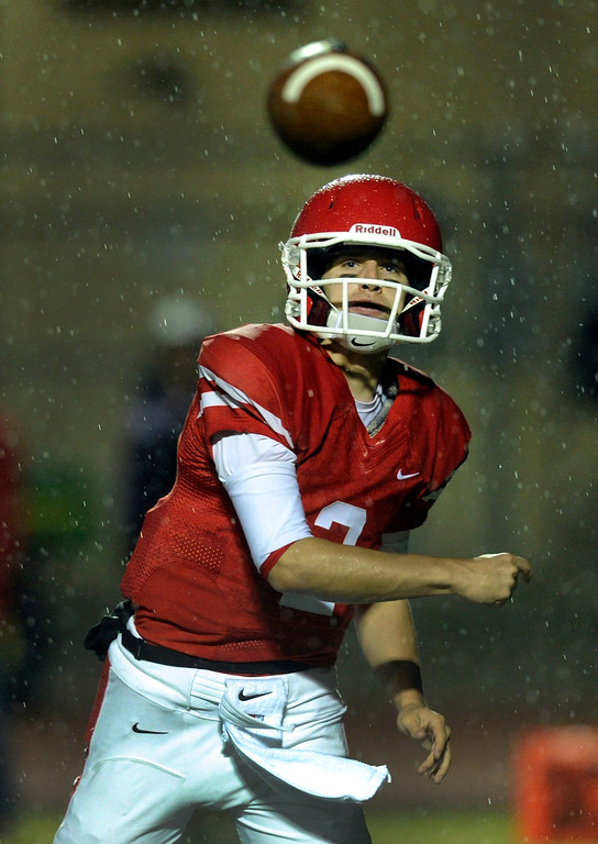 . AURORA, CO. - SEPTEMBER 27: Regis Jesuit quarterback Matt Houghtaling (2) threw a pas through the raindrops in the first half. The Regis Jesuit High School football team hosted ThunderRidge Friday night, September 27, 2013. Photo By Karl Gehring/The Denver Post