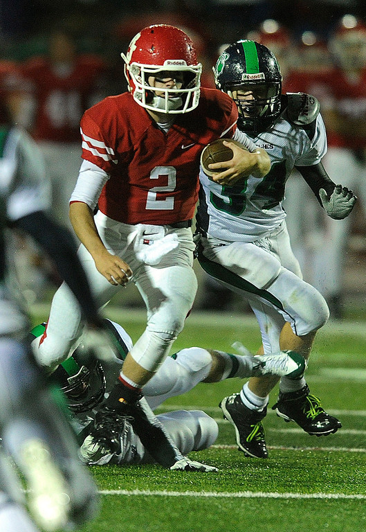 . AURORA, CO. - SEPTEMBER 27: Regis quarterback Matt Houghtaling (2) made a run up the middle in the second half. The Regis Jesuit High School football team steamrolled  ThunderRidge 35-12 Friday night, September 27, 2013. Photo By Karl Gehring/The Denver Post