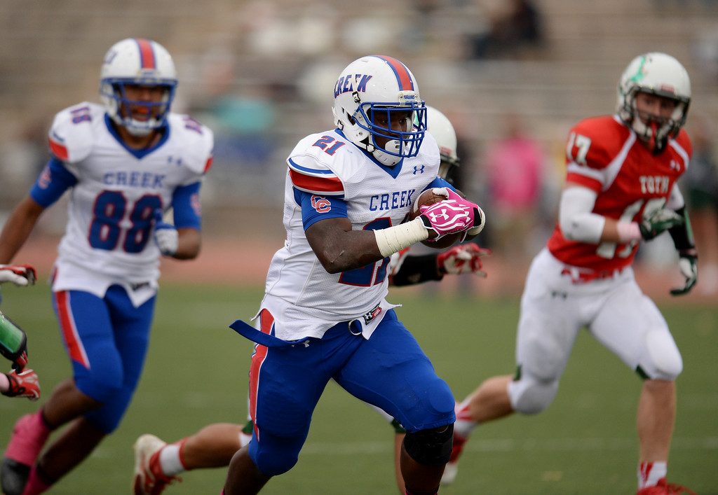 . RB D.J. Luke of Cherry Creek High School (21) rushes against Smoky Hill High School defense in the 2nd quarter of the game at Stutler Bowl. Greenwood Village, Colorado. October 11, 2013. Cherry Creek won 48-14.  (Photo by Hyoung Chang/The Denver Post)
