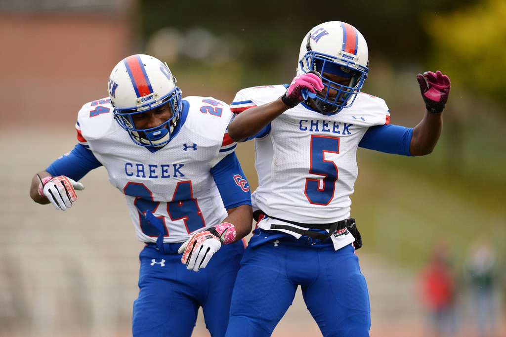 . Nathan Starks (24), and Milo Hall (5) of Cherry Creek High School celebrate Starks\' touchdown in the 1st quarter of the game against Smoky Hill High School at Stutler Bowl. Greenwood Village, Colorado. October 11, 2013. Cherry Creek won 48-14. (Photo by Hyoung Chang/The Denver Post)