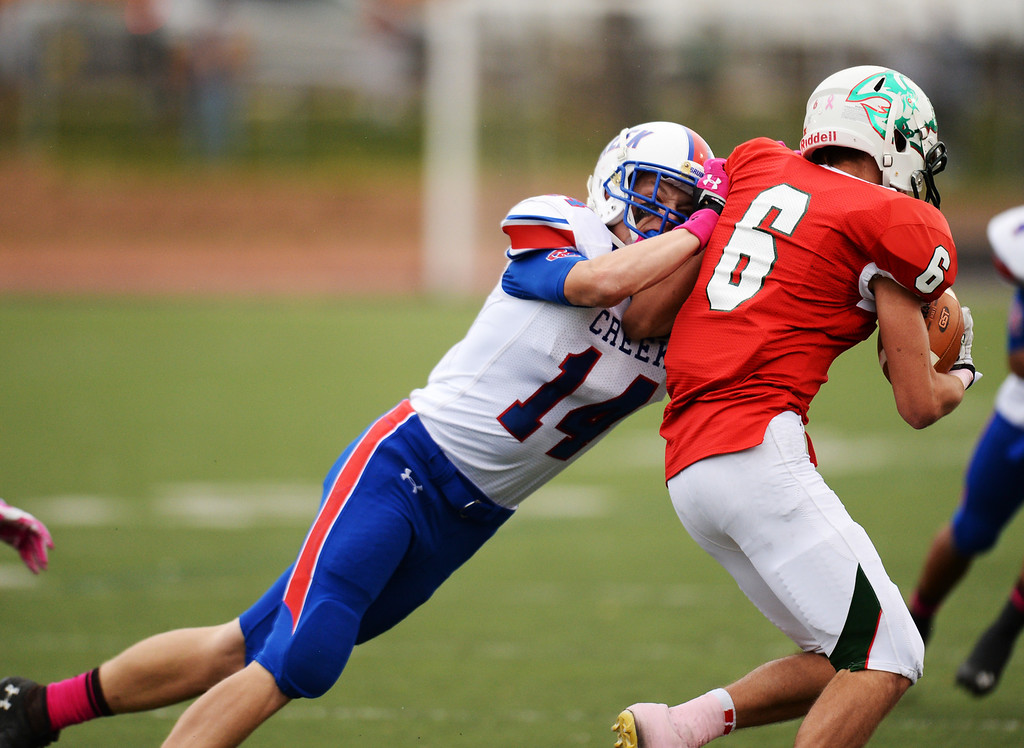 . Jaeden Graham of Cherry Creek High School (14) tackles Frank Thomas of Smoky Hill High School (6) in the 1st quarter of the game at Stutler Bowl. Greenwood Village, Colorado. October 11, 2013. Cherry Creek won 48-14. (Photo by Hyoung Chang/The Denver Post)