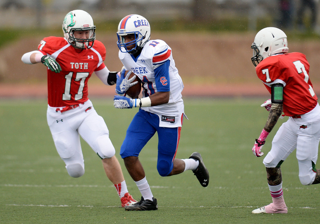 . WR Kris Taylor-Keel of Cherry Creek High School (11) complete the pass between Hank Hyde (17) and Tahir Hopkins (7) of Smoky Hill High School at Stutler Bowl. Greenwood Village, Colorado. October 11, 2013. (Photo by Hyoung Chang/The Denver Post)