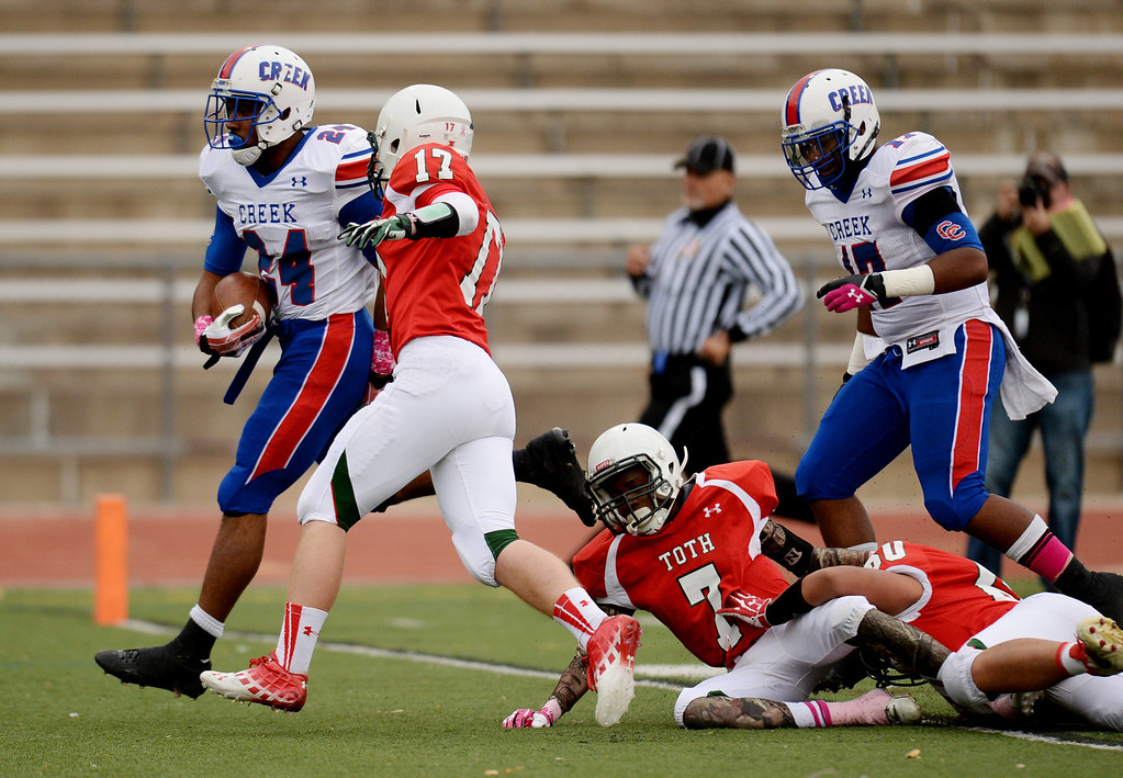 . RB Nathan Starks of Cherry Creek High School (24) scores a touchdown in the 1st quarter of the game against Smoky Hill High School at Stutler Bowl. Greenwood Village, Colorado. October 11, 2013. (Photo by Hyoung Chang/The Denver Post)