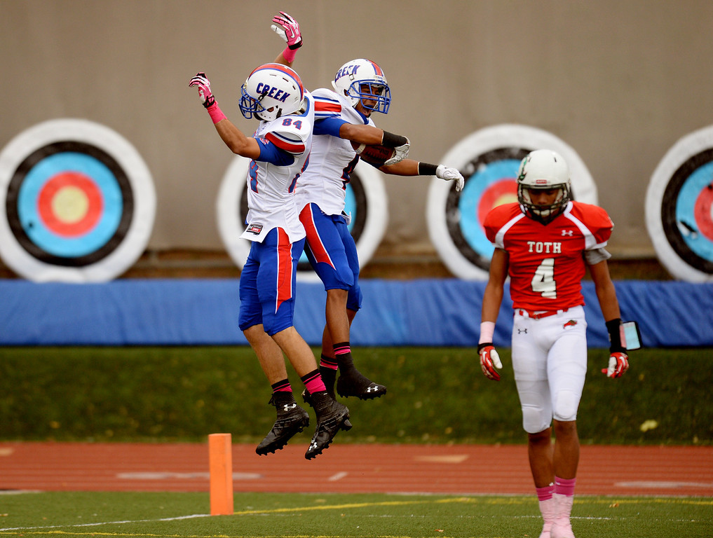 . Cody Wood (84) and Tyus Carter (4) of Cherry Creek High School celebrate Carter\'s touchdown by Dominique Carasco of Smoky Hill High School (4), right, in the 1st quarter of the game at Stutler Bowl. Greenwood Village, Colorado. October 11, 2013. Cherry Creek won 48-14. (Photo by Hyoung Chang/The Denver Post)
