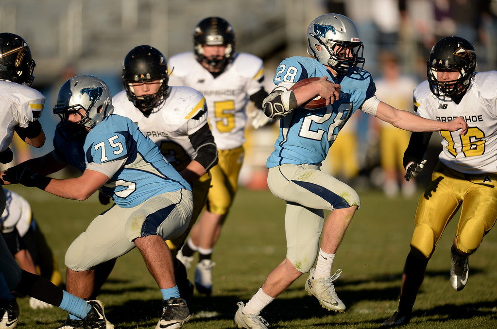 . ARVADA, CO - NOVEMBER 01 : Andrew Wingard of Ralston Valley High School (28) controls the ball against Arapahoe High School defense in the 1st half of the game at NAAC Stadium. Arvada, Colorado. November 01, 2013. Ralston Valley won 58-28. (Photo by Hyoung Chang/The Denver Post)