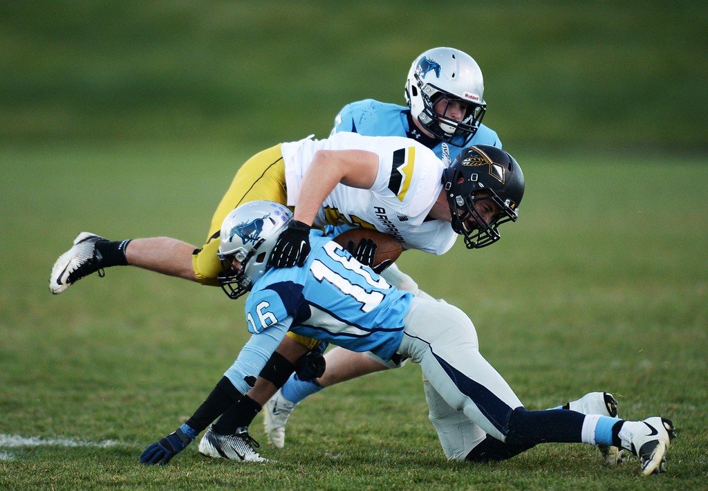 . ARVADA, CO - NOVEMBER 01 : Mitchell Robinson of Ralston Valley High School (16) tackles Brandon Jewell of Arapahoe High School (2)  in the 2nd half of the game at NAAC Stadium. Arvada, Colorado. November 01, 2013. Ralston Valley won 58-28. (Photo by Hyoung Chang/The Denver Post)