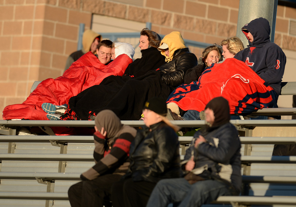. ARVADA, CO - NOVEMBER 01 : Arapahoe High School fans cheer for their team despite the wind during the game against Ralston Valley High School at NAAC Stadium. Arvada, Colorado. November 01, 2013. Ralston Valley won 58-28. (Photo by Hyoung Chang/The Denver Post)
