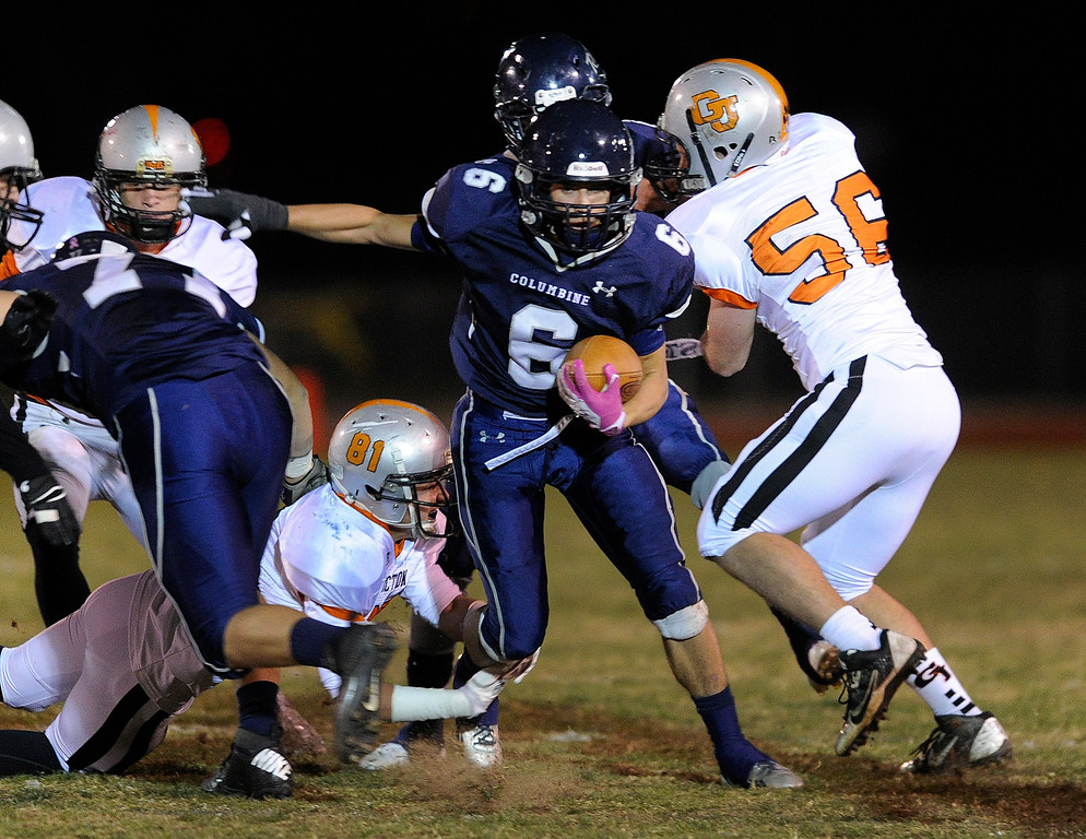 . LAKEWOOD, CO. - NOVEMBER 8: Rebels running back Austin Norton (6) ran up the middle in the first half. The Columbine High School football team faced Grand Junction in a playoff game at Jefferson County Stadium Friday night, November 8, 2013. Photo By Karl Gehring/The Denver Post