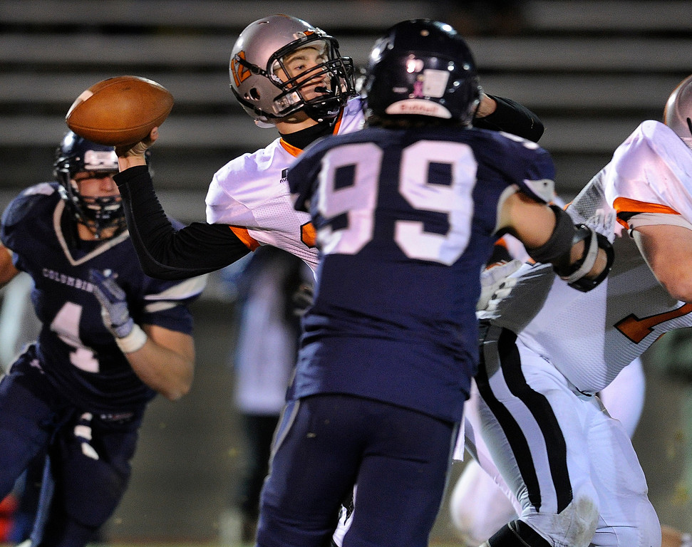 . LAKEWOOD, CO. - NOVEMBER 8: Grand Junction quarterback Tyler Heinsma threw under pressure in the second half. The Columbine High School football team rolled over Grand Junction 41-6 in a playoff game at Jefferson County Stadium Friday night, November 8, 2013. Photo By Karl Gehring/The Denver Post