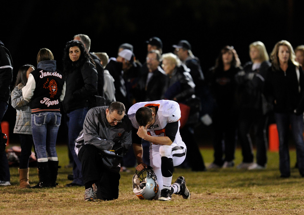 . LAKEWOOD, CO. - NOVEMBER 8: Grand Junction senior Theron Verna absorbed the emotional end to the season Friday night. The Columbine High School football team rolled over Grand Junction 41-6 in a playoff game at Jefferson County Stadium Friday night, November 8, 2013. Photo By Karl Gehring/The Denver Post
