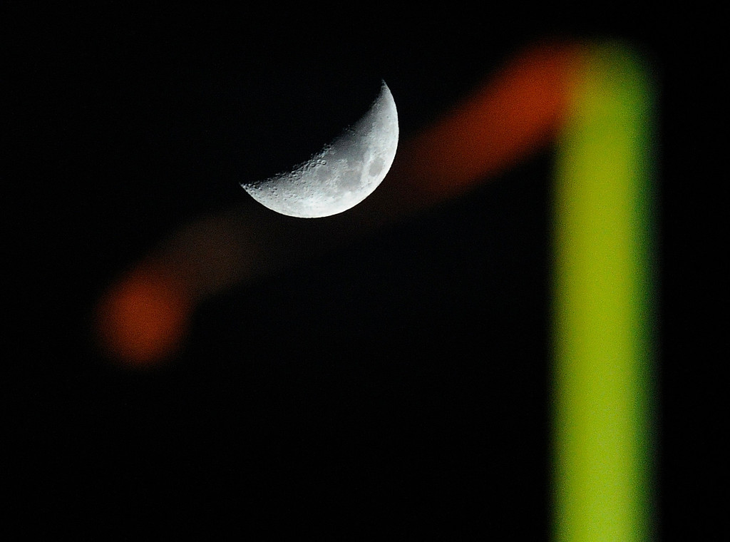 . LAKEWOOD, CO. - NOVEMBER 8: A crescent moon was illuminated beyond the goalposts of Jefferson County Stadium Friday night. The Columbine High School football team rolled over Grand Junction 41-6 in a playoff game in Lakewood Friday night, November 8, 2013. Photo By Karl Gehring/The Denver Post