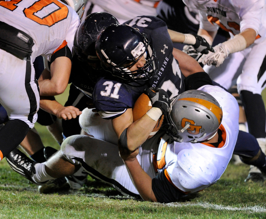 . LAKEWOOD, CO. - NOVEMBER 8: Columbine running back Jeremy Aparicio (31) pushed his way into the end zone for a touchdown in the second half. The Columbine High School football team rolled over Grand Junction 41-6 in a playoff game at Jefferson County Stadium Friday night, November 8, 2013. Photo By Karl Gehring/The Denver Post