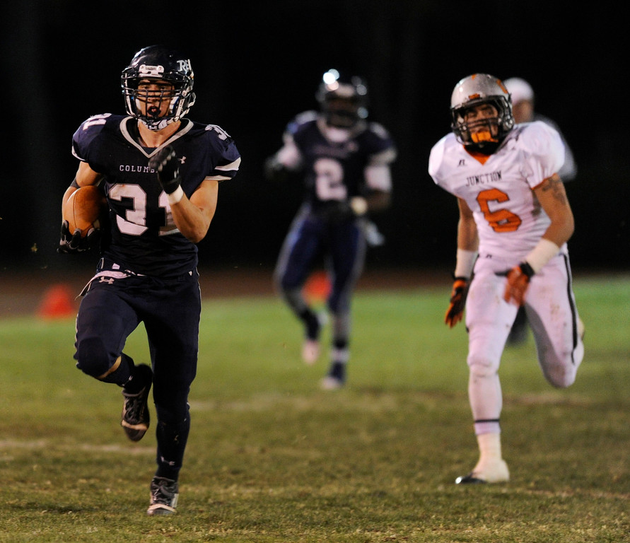 . LAKEWOOD, CO. - NOVEMBER 8: Rebels running back Jeremy Aparicio (31) outran every Grand Junction defender for a long touchdown in the second quarter. The Columbine High School football team faced Grand Junction in a playoff game at Jefferson County Stadium Friday night, November 8, 2013. Photo By Karl Gehring/The Denver Post