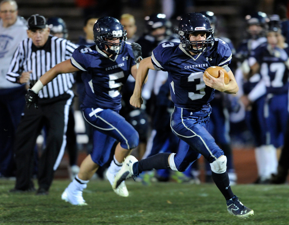 . LAKEWOOD, CO. - NOVEMBER 8: Columbine quarterback Michael Tait (3) called his own number on a touchdown run in the first half. The Columbine High School football team faced Grand Junction in a playoff game at Jefferson County Stadium Friday night, November 8, 2013. Photo By Karl Gehring/The Denver Post