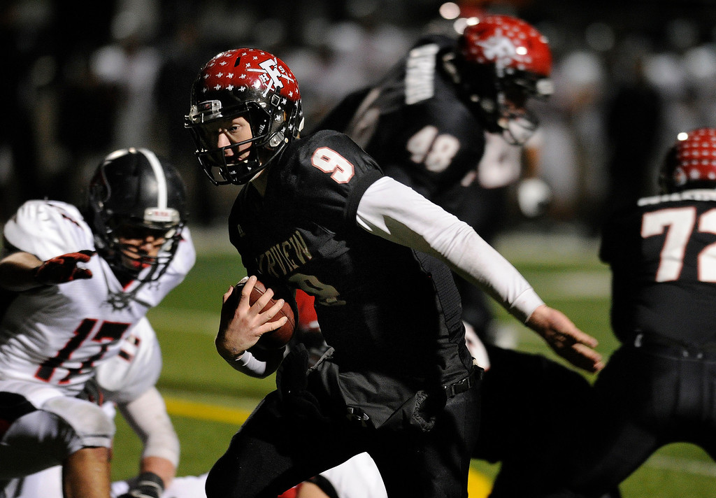 . BOULDER, CO. - NOVEMBER 15: Fairview quarterback Anders Hill found his way to the end zone in the second half. The Fairview High School football team defeated Pomona 35-24 Friday night, November 15, 2013. Photo By Karl Gehring/The Denver Post