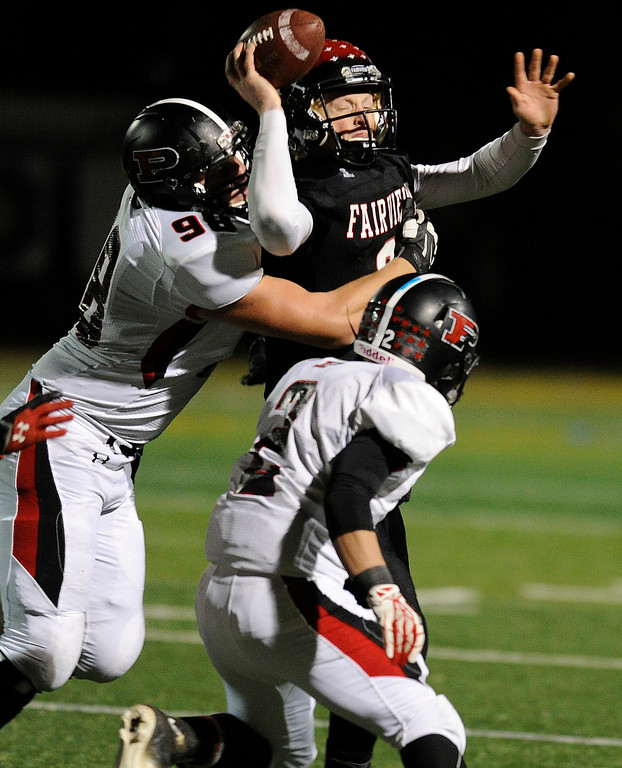 . BOULDER, CO. - NOVEMBER 15: Fairview quarterback Anders Hill (9) threw under pressure from Pomona lineman Tyler Weir (98) in the first half. Hill\'s pass was intercepted by Pomona\'s Isaac Marquez. The Fairview High School football team hosted Pomona Friday night, November 15, 2003. Photo By Karl Gehring/The Denver Post