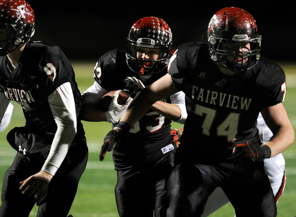 . BOULDER, CO. - NOVEMBER 15: Fairview ball carrier Sam Martin (83) followed his blockers into the end zone for a touchdown in the second half. The Fairview High School football team defeated Pomona 35-24 Friday night, November 15, 2013. Photo By Karl Gehring/The Denver Post