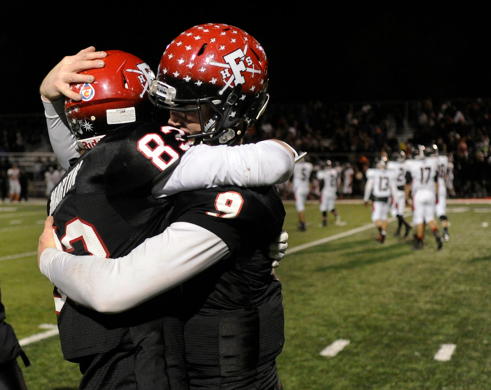. BOULDER, CO. - NOVEMBER 15: Wide receiver Sam Martin and quarterback Anders Hill embraced at the end of the game. The Fairview High School football team defeated Pomona 35-24 Friday night, November 15, 2013. Photo By Karl Gehring/The Denver Post