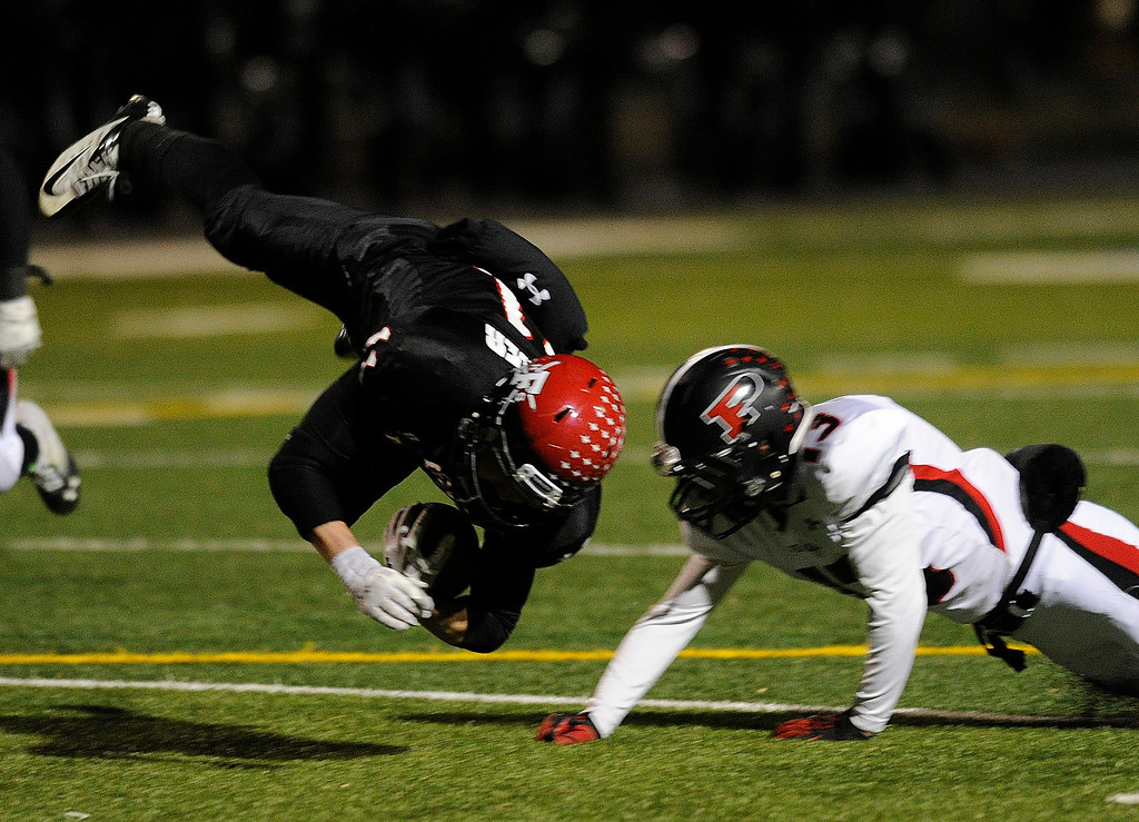 . BOULDER, CO. - NOVEMBER 15: Pomona defensive back Taylor Thomas, right, knocked Fairview wide receiver Cameron Frazier, left, off his feet following a catch in the first quarter. The Fairview High School football team hosted Pomona Friday night, November 15, 2003. Photo By Karl Gehring/The Denver Post