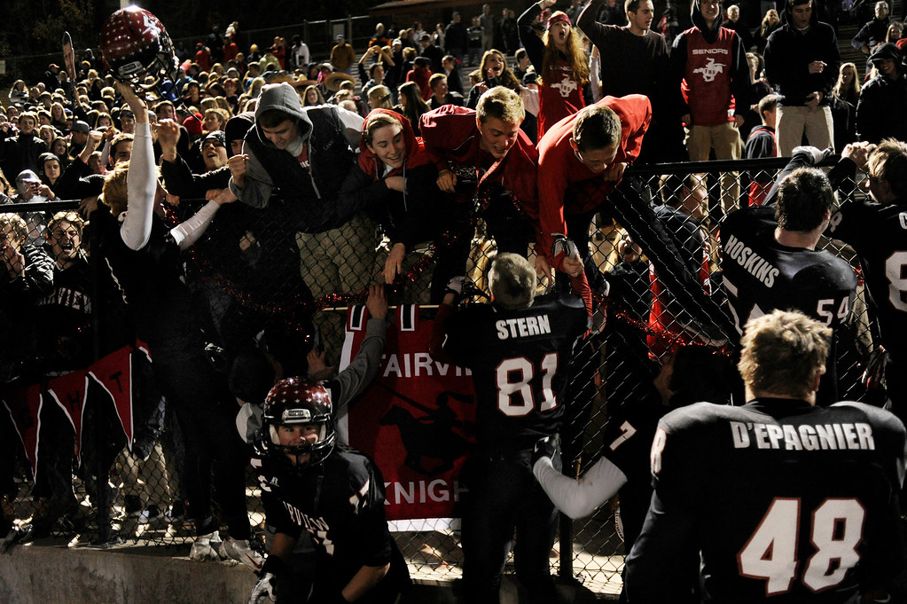 . BOULDER, CO. - NOVEMBER 15: The Knights celebrated with fans following the win Friday night. The Fairview High School football team defeated Pomona 35-24 Friday night, November 15, 2013. Photo By Karl Gehring/The Denver Post